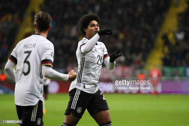 Serge Gnabry of Germany celebrates after scoring his team`s first goal during the UEFA Euro 2020 Qualifier between Germany and Northern Ireland at...