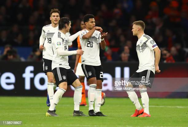 Serge Gnabry of Germany celebrates after scoring his team's second goal with team mates during the 2020 UEFA European Championships Group C...