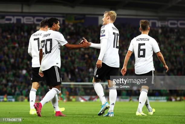Serge Gnabry of Germany celebrates after scoring his team's second goal with Julian Brandt of Germany during the UEFA Euro 2020 qualifier match...
