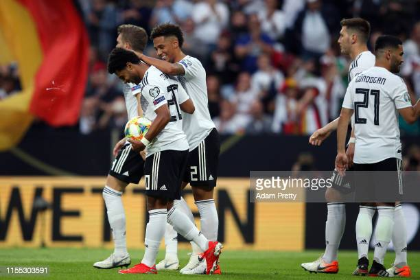 Serge Gnabry of Germany celebrates his second goal during the UEFA Euro 2020 Qualifier match between Germany and Estonia at Opel Arena on June 11...