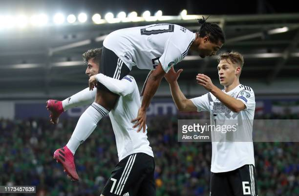 Serge Gnabry of Germany celebrates his team's second goal with team mates Kai Havertz and Julian Brandt during the UEFA Euro 2020 qualifier match...