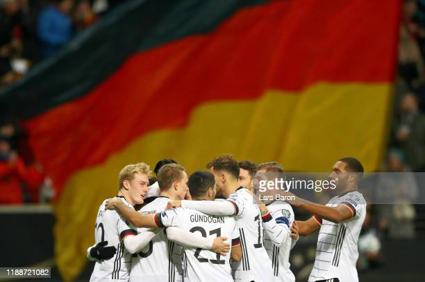 Serge Gnabry of Germany celebrates with his team mates after scoring his team's third goal during the UEFA Euro 2020 Qualifier between Germany and...