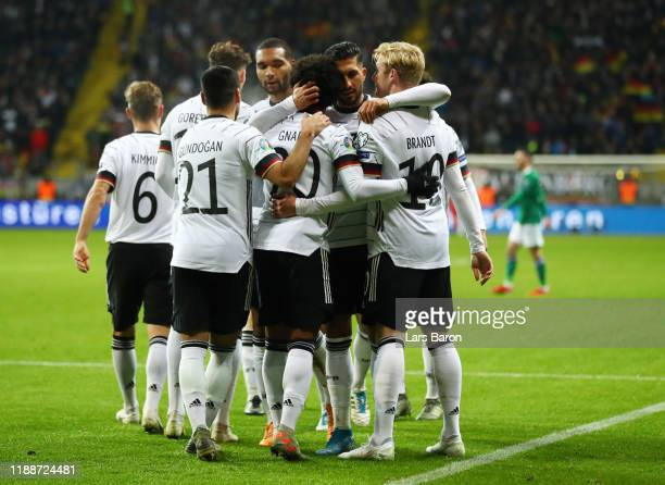 Serge Gnabry of Germany celebrates with his team mates after scoring his team's fourth goal during the UEFA Euro 2020 Qualifier between Germany and...