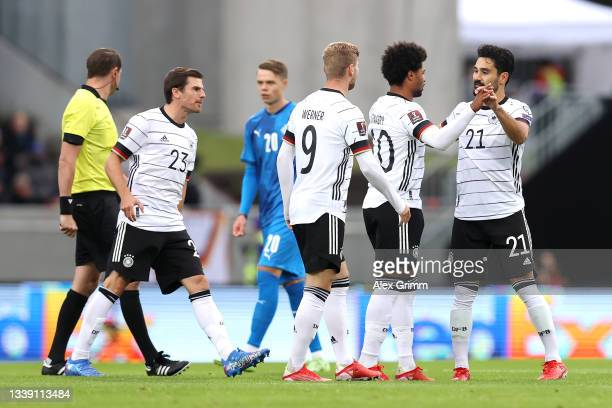Serge Gnabry of Germany celebrates with Ilkay Guendogan after scoring their side's first goal during the 2022 FIFA World Cup Qualifier match between...