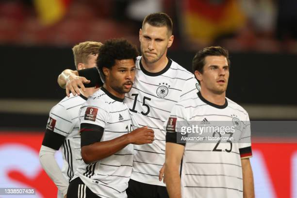 Serge Gnabry of Germany celebrates with Niklas Sule after scoring their team's second goal during the 2022 FIFA World Cup Qualifier match between...