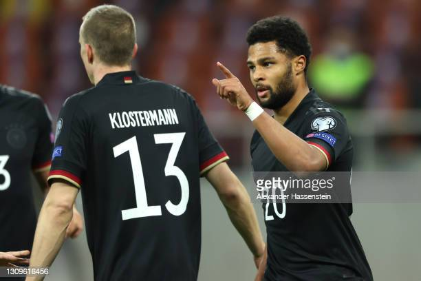 Serge Gnabry of Germany celebrates with team mate Lukas Klostermann after scoring their side's first goal during the FIFA World Cup 2022 Qatar...