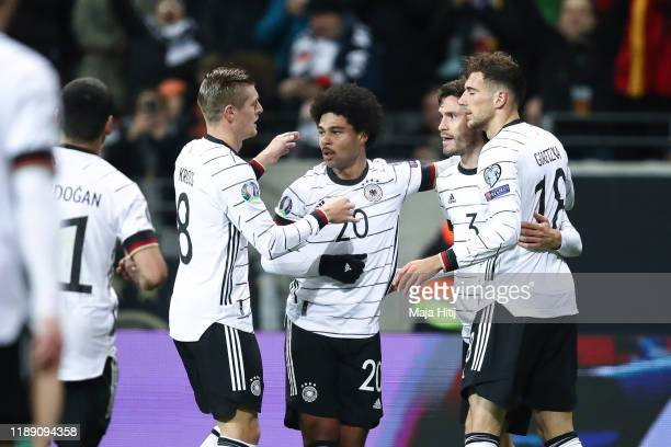 Serge Gnabry of Germany celebrates with teammates after scoring his team's first goal during the UEFA Euro 2020 Qualifier between Germany and...