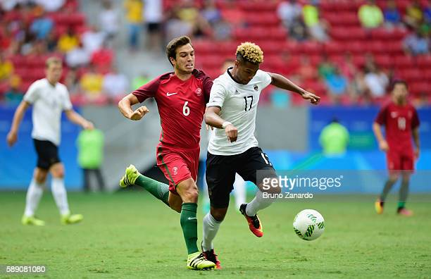 Serge Gnabry of Germany controls the ball against Tomas Martins Podstawski of Portugal in the first half during the Men's Football Quarterfinal match...