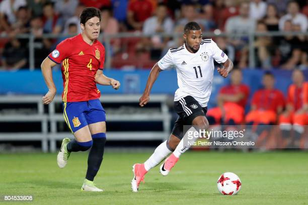 Serge Gnabry of Germany gets away from Jorge Mere of Spain during the UEFA European Under21 Championship Final between Germany and Spain at Krakow...