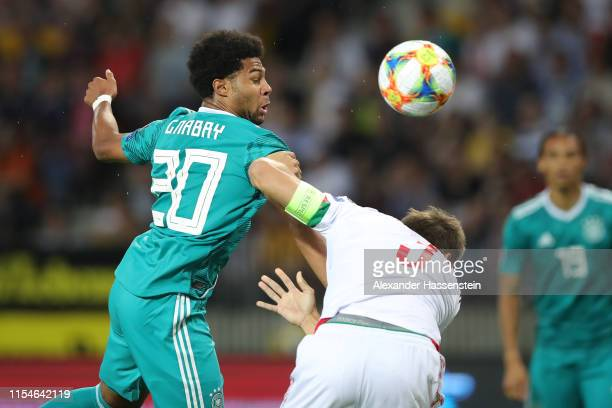 Serge Gnabry of Germany is challenged by Aleksandr Martynovich of Belarus during the UEFA Euro 2020 qualifier match between Belarus and Germany at...