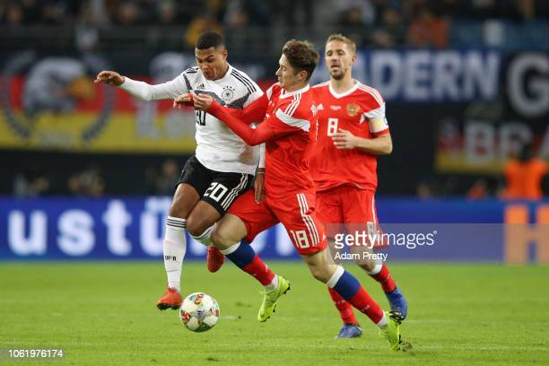 Serge Gnabry of Germany is challenged by Anton Miranchuk of Russia during the International Friendly match between Germany and Russia at Red Bull...