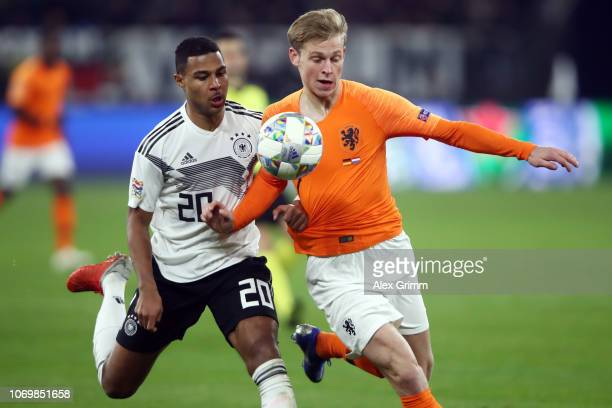 Serge Gnabry of Germany is challenged by Frenkie de Jong of Netherlands during the UEFA Nations League A group one match between Germany and...