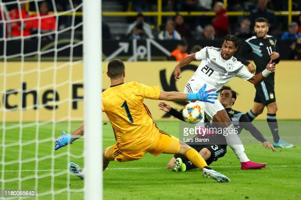 Serge Gnabry of Germany scores his team's first goal during the International Friendly match between Germany and Argentina at Signal Iduna Park on...