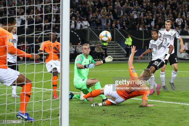 Serge Gnabry of Germany scores his team's first goal during the UEFA Euro 2020 qualifier match between Germany and Netherlands at Volksparkstadion on...