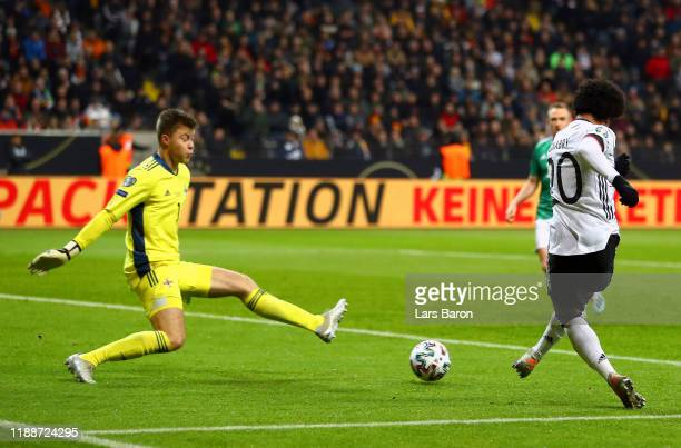 Serge Gnabry of Germany scores his team's fourth goal past Bailey PeacockFarrell of Northern Ireland during the UEFA Euro 2020 Qualifier between...