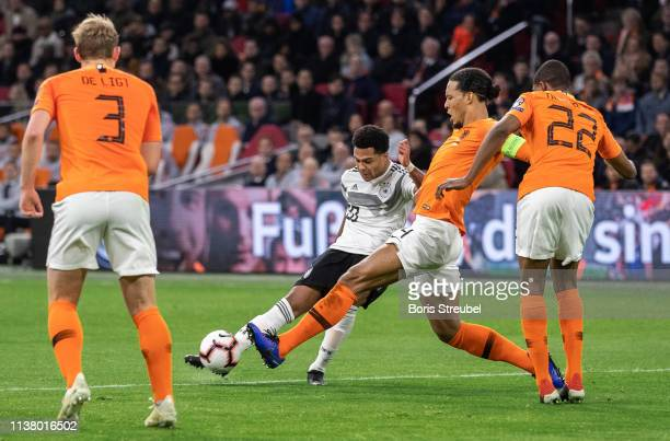 Serge Gnabry of Germany scores his team's second goal during the 2020 UEFA European Championships group C qualifying match between Netherlands and...