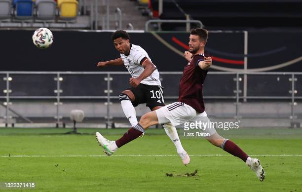 Serge Gnabry of Germany scores their sides fifth goal past Roberts Ozols of Latvia during the international friendly match between Germany and Latvia...