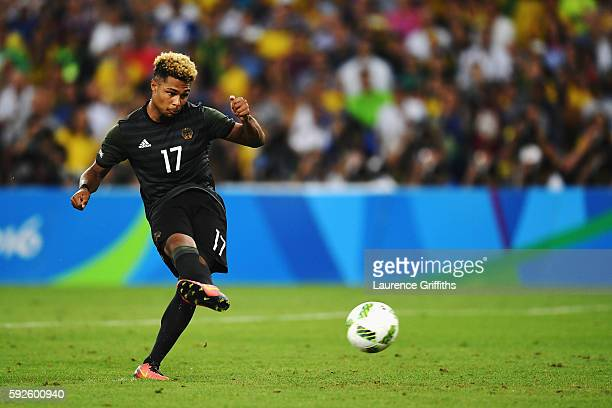 Serge Gnabry of Germany takes his penalty in the shoot out during the Men's Football Final between Brazil and Germany at the Maracana Stadium on Day...