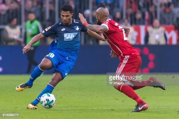 Serge Gnabry of Hoffenheim and Arturo Vidal of Bayern Muenchen battle for the ball during the Bundesliga match between FC Bayern Muenchen and TSG...