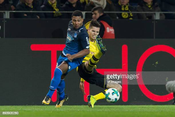 Serge Gnabry of Hoffenheim and Julian Weigl of Dortmund battle for the ball during the Bundesliga match between Borussia Dortmund and TSG 1899...