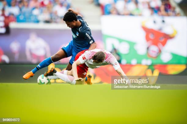 Serge Gnabry of Hoffenheim and Lukas Klostermann of Leipzig compete for the ball during the Bundesliga match between RB Leipzig and TSG 1899...