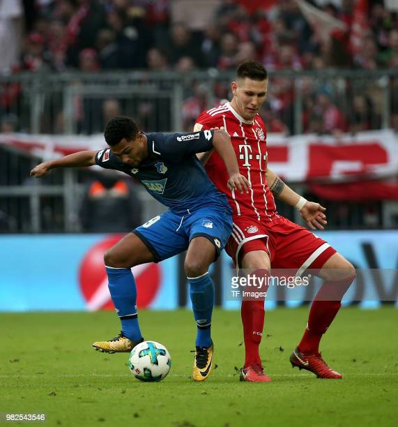 Serge Gnabry of Hoffenheim and Niklas Suele of Muenchen battle for the ball during the Bundesliga match between FC Bayern Muenchen and TSG 1899...