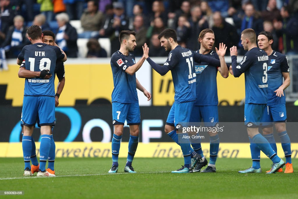 Serge Gnabry of Hoffenheim (left covered) celebrates after he scored a goal to make it 2:0, together with Mark Uth of Hoffenheim, during the Bundesliga match between TSG 1899 Hoffenheim and VfL Wolfsburg at Wirsol Rhein-Neckar-Arena on March 10, 2018 in Sinsheim, Germany.