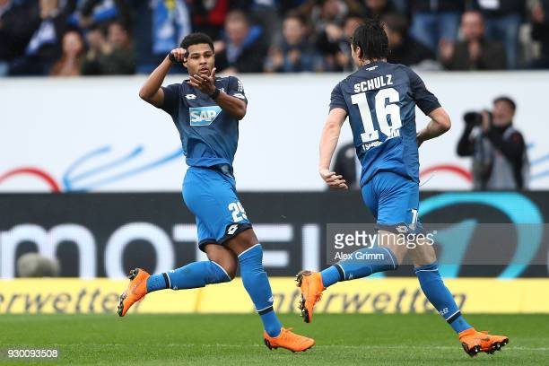 Serge Gnabry of Hoffenheim celebrates after he scored a goal to make it 20 together with Nico Schulz of Hoffenheim during the Bundesliga match...