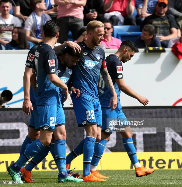 Serge Gnabry of Hoffenheim celebrates after scoring his team`s first goal with team mates during the Bundesliga match between TSG 1899 Hoffenheim and...