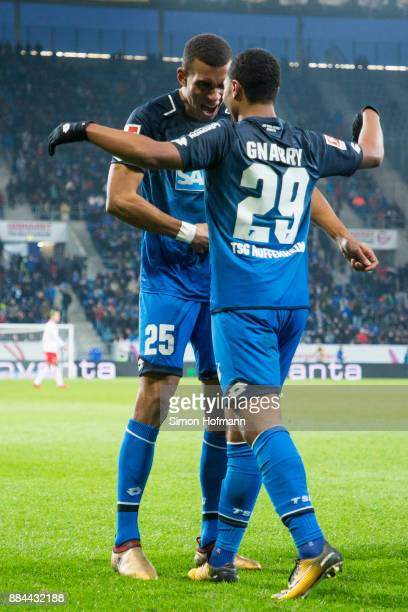 Serge Gnabry of Hoffenheim celebrates his team's second goal with team mate Kevin Akpoguma during the Bundesliga match between TSG 1899 Hoffenheim...