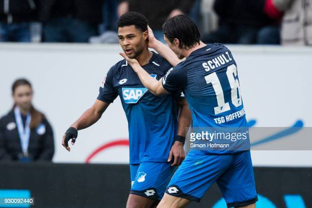 Serge Gnabry of Hoffenheim celebrates his team's second goal with team mate Nico Schulz during the Bundesliga match between TSG 1899 Hoffenheim and...