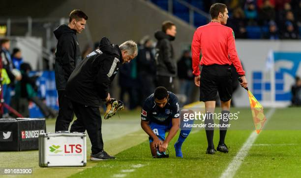 Serge Gnabry of Hoffenheim changes his shoes during the Bundesliga match between TSG 1899 Hoffenheim and VfB Stuttgart at Wirsol RheinNeckarArena on...