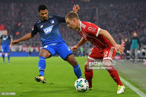 Serge Gnabry of Hoffenheim fights for the ball with Joshua Kimmich of Bayern Muenchen during the Bundesliga match between FC Bayern Muenchen and TSG...