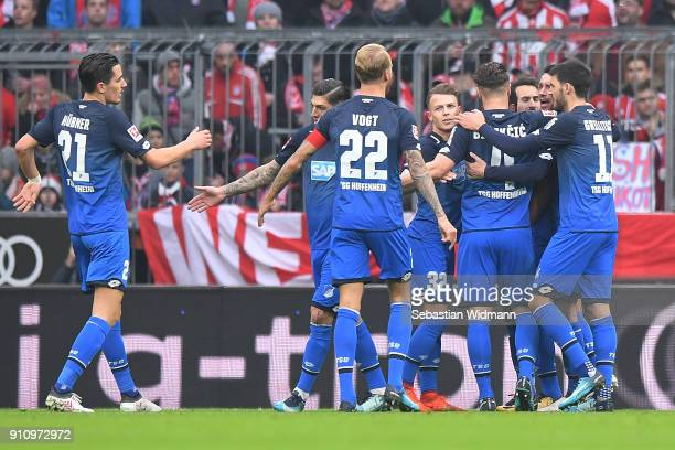 Serge Gnabry of Hoffenheim is celebrated by his team after he scored a goal to make it 02 during the Bundesliga match between FC Bayern Muenchen and...