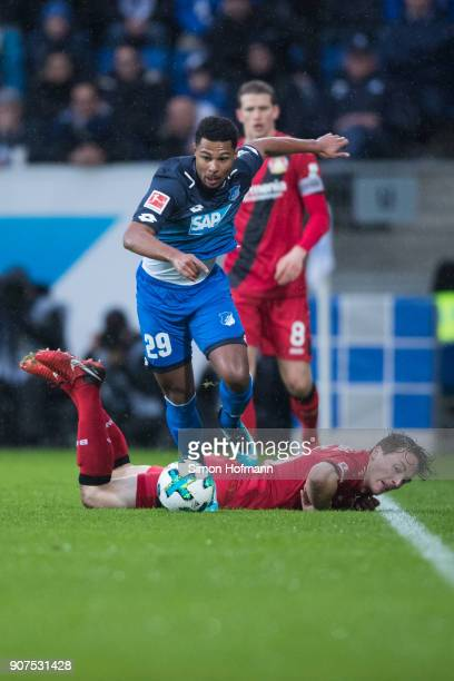 Serge Gnabry of Hoffenheim is challenged by Julian Baumgartlinger of Leverkusen during the Bundesliga match between TSG 1899 Hoffenheim and Bayer 04...
