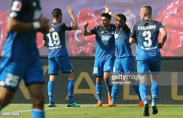Serge Gnabry of Hoffenheim jubilates with team mates after scoring the second goal during the Bundesliga match between RB Leipzig and TSG 1899...
