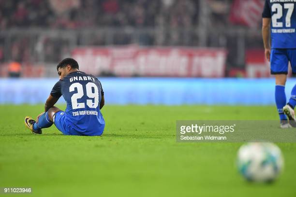 Serge Gnabry of Hoffenheim on the pitch dejected after the Bundesliga match between FC Bayern Muenchen and TSG 1899 Hoffenheim at Allianz Arena on...