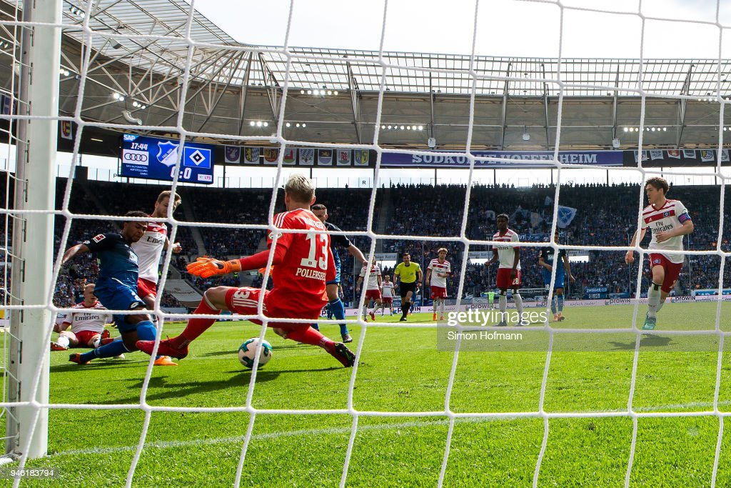 Serge Gnabry of Hoffenheim (l) scores a goal to make it 1:0 past goalkeeper Julian Pollersbeck of Hamburg during the Bundesliga match between TSG 1899 Hoffenheim and Hamburger SV at Wirsol Rhein-Neckar-Arena on April 14, 2018 in Sinsheim, Germany.