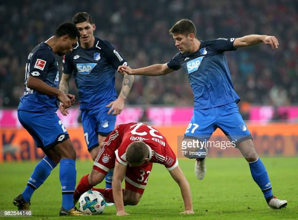 Serge Gnabry of Hoffenheim Steven Zuber of Hoffenheim Joshua Kimmich of Muenchen and Andrej Kramaric of Hoffenheim battle for the ball during the...