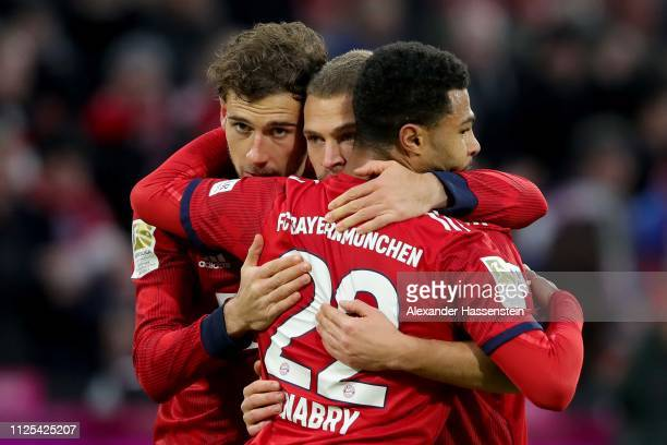 Serge Gnabry of Muebchen celebrates scoring the 3rd goal with hsi team mates Leon Goretzka and Joshua Kimmich during the Bundesliga match between FC...