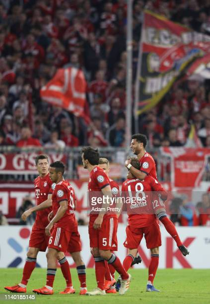 Serge Gnabry of Muenchen celebrates his team's fourth goal with team mate Leon Goretzka during the DFB Cup quarterfinal match between Bayern Muenchen...