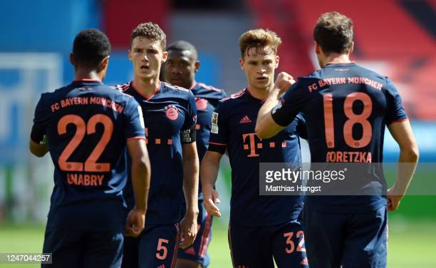 Serge Gnabry of Muenchen celebrates his team's third goal with teammates Benjamin Pavard Joshua Kimmich and Leon Goretzka during the Bundesliga match...