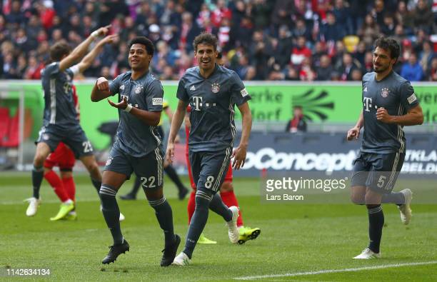 Serge Gnabry of Muenchen celebrates scoring his team's third goal during the Bundesliga match between Fortuna Duesseldorf and FC Bayern Muenchen at...