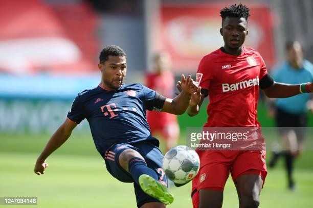 Serge Gnabry of Muenchen scores his team's third goal against Edmond Tapsoda of Leverkusen during the Bundesliga match between Bayer 04 Leverkusen...