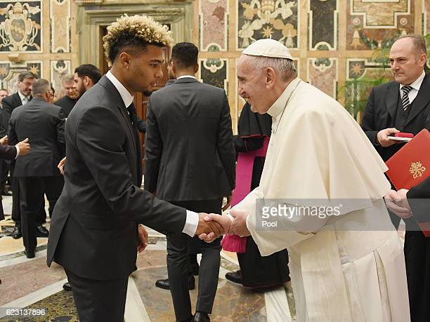 Serge Gnabry shakes hands with Pope Francis during a private audience with Pope Francis at the Vatican Palace on November 14 2016 in Vatican City...