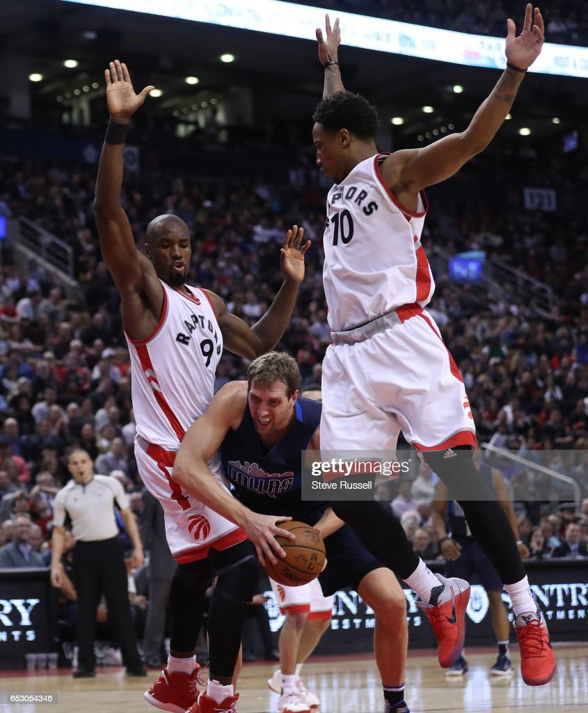 TORONTO, ON- MARCH 13 - Serge Ibaka and DeMar DeRozan defend against Dirk Nowitzki as the Toronto Raptors beat the Dallas Mavericks 100-78 at the Air Canada Centre in Toronto. March 13, 2017.