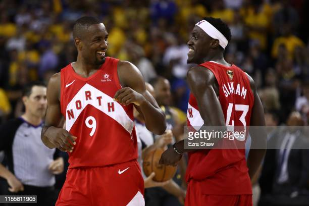 Serge Ibaka and Pascal Siakam of the Toronto Raptors celebrate late in the game against the Golden State Warriors during Game Six of the 2019 NBA...