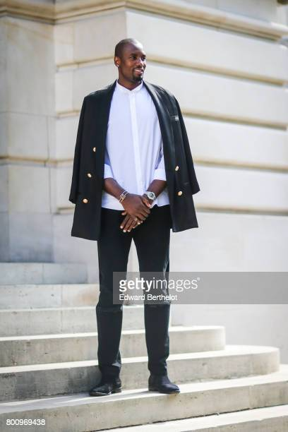 Serge Ibaka attends the Balmain Menswear Spring/Summer 2018 show as part of Paris Fashion Week on June 24 2017 in Paris France