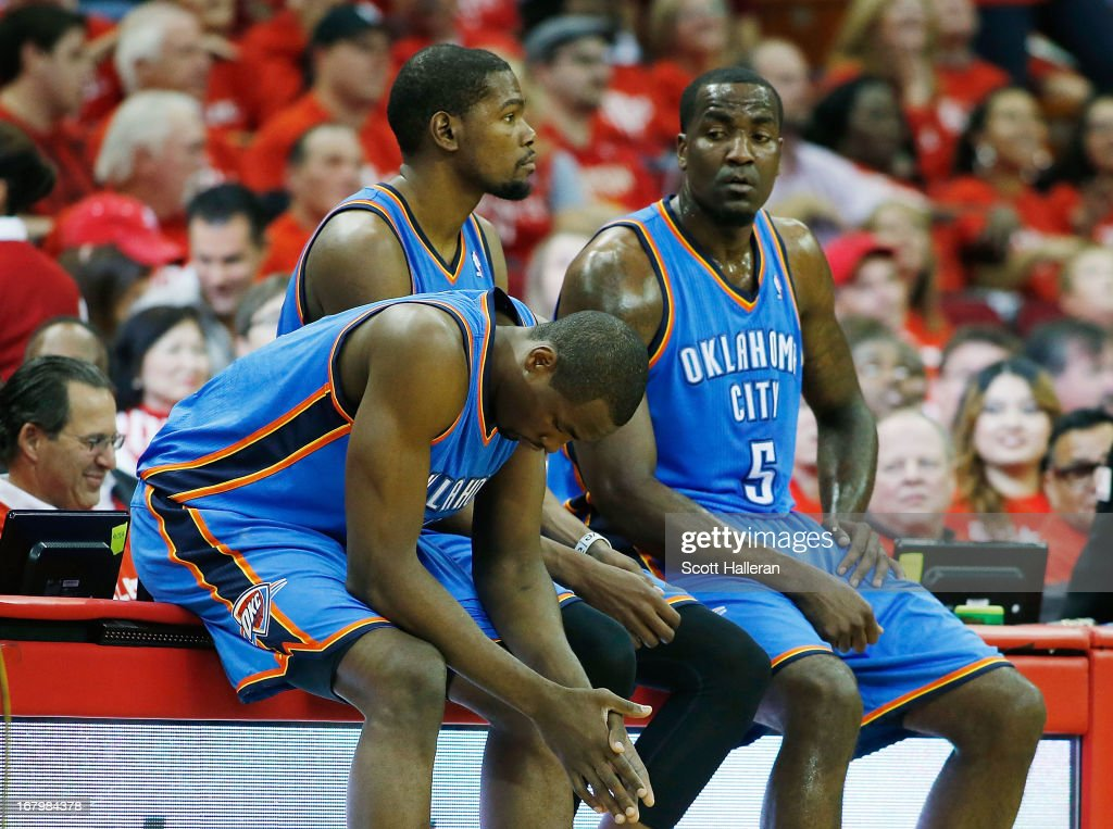 Serge Ibaka #9, Kevin Durant #35 and Kendrick Perkins #5 of the Oklahoma City Thunder wait to enter the game against the Houston Rockets in Game Six of the Western Conference Quarterfinals of the 2013 NBA Playoffs at the Toyota Center on May 3, 2013 in Houston, Texas.