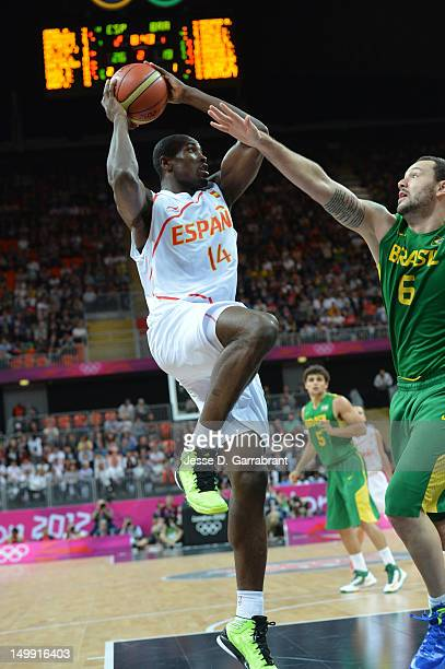 Serge Ibaka of Spain shoots against Caio Torres of Brazil during their Men's Basketball Game on Day 10 of the London 2012 Olympic Games at the...